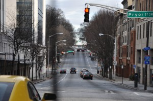 The Mitchell Street corridor leads east from Spring Street, between the Fulton County Courthouse and commercial structures, with the state Capitol near the top of the hill, on the left. Credit: Donita Pendered