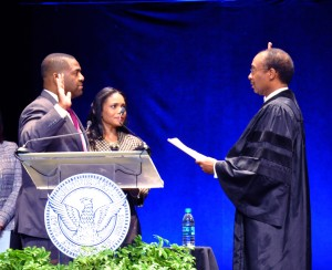 Atlanta City Council President Ceasar Mitchell takes the oath of office from Judge Steve C. Jones, of the U.S. District Court in Atlanta. Credit: Donita Pendered