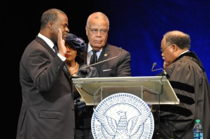 Atlanta Mayor Kasim Reed takes the oath of office from Robert Benham, the first African American justice of the Georgia Supreme Court. Credit: Donita Pendered