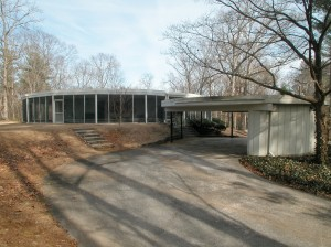 The back of the house with a circular carport