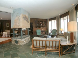 The living room area with fireplace on the left