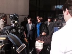 In February lawyers for opponents of Atlanta's plan to sell bonds for the Falcons stadium talk with reporters after a hearing: John Woodham (center, left) Thelma Wyatt Moore (center, right). File/Credit: David Pendered