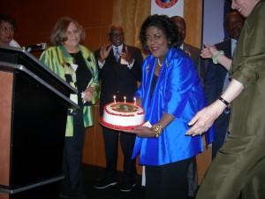 Bringing out the birthday cake for Maynard Jackson
