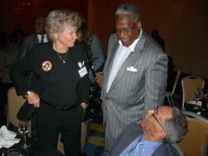 Sharon Adams and Julius Hollis speak with a dinner guest