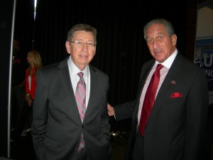 Frank Poe of the Georgia World Congress Center Authority visits with Arthur Blank.