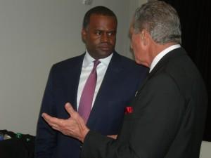Arthur Blank talks to Atlanta Mayor Kasim Reed before the announcement