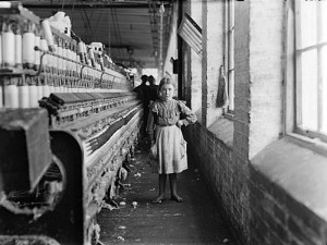 A young girl works as a spinner in a Georgia cotton mill, 1909. Credit: Library of Congress