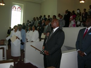 An overflowing, standing room only crowd attends Friendship's last service