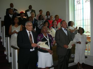 Former Morehouse College President Robert Franklin and his wife, attending as guests, sing along