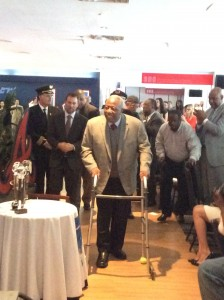 Hank Aaron surprises the luncheon crowd when he enters the room