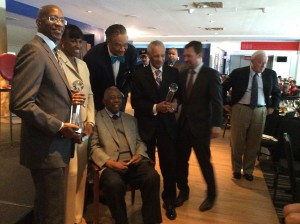 All the honorees together - Edwin Moses, Jackie Joyner-Kersee, Joe Barry Carroll towering above Hank Aaron, Rev. C.T. Vivian, Doug Shipman and Bill Bartholomay stands to the right