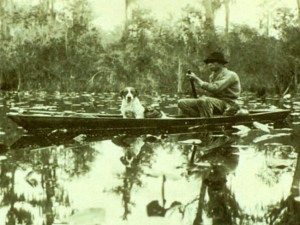 Traditional poled boats, suited to maneuvering in tight water, were used in the days of alligator hunting and frog gigging, before the swamp became a federal wildlife refuge. Credit: Zach S. Henderson Library, Special Collections, Georgia Southern University Libraries