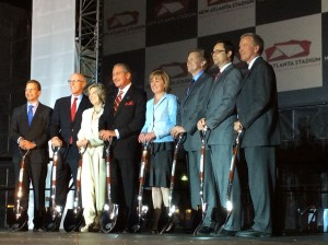 Arthur Blank and his associates pose for pictures after the ground-breaking