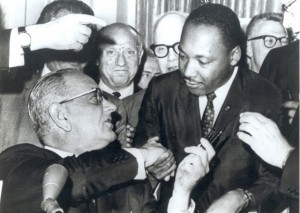 President Lyndon B. Johnson hands his pen to Martin Luther King Jr. after signing the Civil Rights Act of 1964.