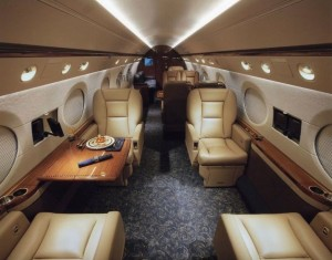 Office work can be done in this plush setting aboard the Gulfstream G650 aircraft, while cruising at 685 mph for more than 8,000 miles on a single fueling. Credit: privatejetseurope.com
