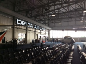 After people have left the event, the lit Delta sign shines on