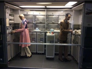 A display inside the Spirit of Delta showing two flight attendants at work
