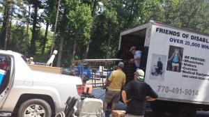 North Atlanta Rotarians load a donated hospital bed into a FODAC truck. Credit: FODAC