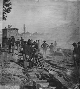 Union troops destroying railroad tracks in Atlanta, 1864. Photograph by George N. Barnard