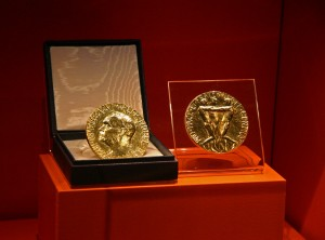 The actual Nobel Peace Prize medals on display at the Carter Center - the gold one is on the left and the bronze one is on the right