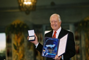 Former U.S. President Jimmy Carter with the Nobel Peace Prize (Photos courtesy of the Carter Library)