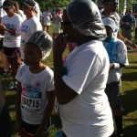Photo of participants in the Color Vibe 5K who are wearing shower caps.