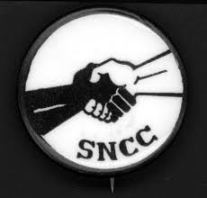 SNCC (Student Nonviolent Coordinating Committee) pin. In 1963 John Lewis became the chair of the organization, which was committed to direct action.