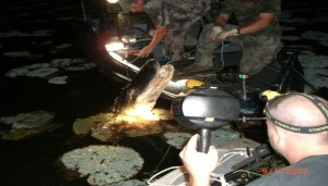 A gator is brought onto a boat in this picture from Coweta County Gator Getters. Credit: ccgatorgetters.com
