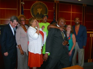 Enjoying the moment - advocates celebrate a step forward for MARTA and Clayton. Clayton Chair Jeff Turner plays around with folks who helped build support for MARTA in his county. Left to right: Robbie Ashe, Rhonda Briggins-Ridley , Deborah Scott, Maceo Williams, Roberta Abdul-Salaam's arm around Turner, Colleen Kiernan and Keith Parker