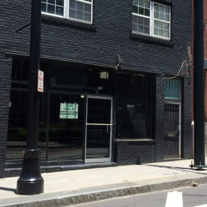 Shuttered storefronts, such as this one along Auburn Avenue, are expected to benefit from passengers brought by the Atlanta Street car. Credit: David Pendered