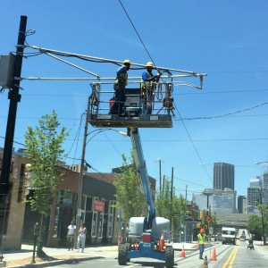 Utility workers put the finishing touches on the power lines of the Atlanta Streetcar over Edgewood Avenue on Wednesday. Credit: David Pendered