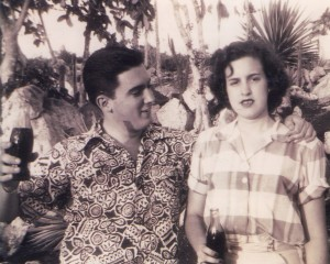 A long-lasting love: Roberto Goizueta, then 16, with Olga, 14, in Cuba. Both are holding bottles of Coca-Cola.
