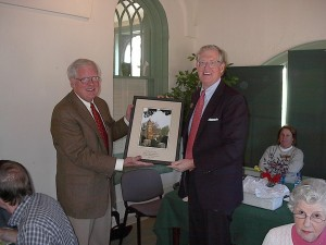 Beau (right) is given a  memento of thanks for his service as board chair of the Historic Oakland Foundation from incoming Chair George Hart (Photo: courtesy of the Historic Oakland Foundation)