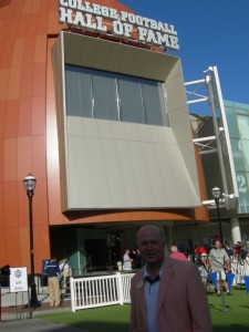 Dan Cathy stands in front of the new College Football Hall of Fame