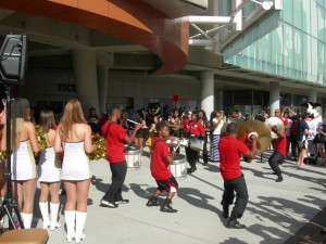 Cheerleaders and marching bands make the opening more festive