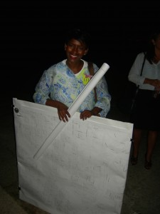 Kay Wallace with her boards and presentations after community meeting