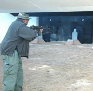 A state authority has scarcely mentioned the status of environmental remediation at Fort McPherson. Here, Clayton County Sheriff's Capt. David A. Bell, who teaches special weapons and tactics, practiced at Fort McPherson in 2008 with a .40-caliber Glock pistol. Credit: army.mil