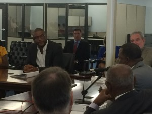 Tyler Perry listens to Mayor Kasim Reed at MILRA board meeting (Photos by Maria Saporta)