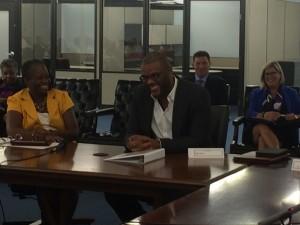 Atlanta City Councilwoman Joyce Sheperd shares a laugh with Tyler Perry at MILRA board meeting