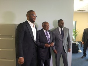 Tyler Perry, MILRA Chairman Felker Ward and Mayor Kasim Reed pose for photos after agreement is announced