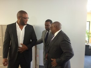 Tyler Perry, Kasim Reed and Felker Ward share a moment after posing for photos