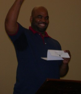 Jeffrey Carr pumps his fist in the air upon reading he has a job with HHRM Concrete