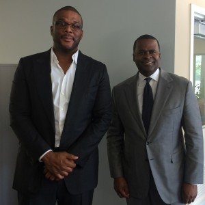 Tyler Perry stands with Mayor Kasim Reed at MILRA board meeting (Photo by Maria Saporta)