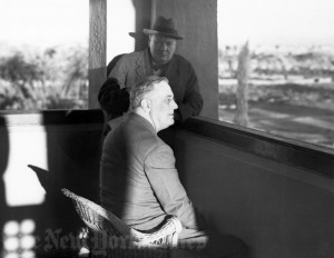 FDR looks out at the Atlas Mountains from the Koutoubia mosque in Marrakesh, Morocco, while Churchill studies his reaction, 1943. Credit: The New York Times