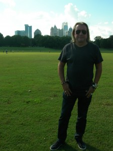 Peter Conlon with the Piedmont Park meadow in the foreground and the Midtown skyline in the background (Photo by Maria Saporta)