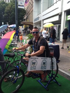 A PARK(ing) Day participant peddles to power the blender affixed to the back of a bicycle
