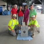 Lynne Falls Shriber (in red shirt) received help from Bill Liss of WXIA and the Ironworkers in retrieving the granite marker for her brother. Its future was in doubt because the Braves will leave Turner Field after the 2015 season for a new ballpark in Cobb County. (Photo courtesy of Jackie Falls)