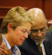 Tony Axam confers with Clayton County District Attorney Tracy Graham Lawson during a trial this month. Credit: henryherald.com