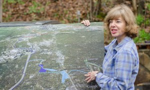 Nancy Jones, executive director of the Blue Heron Nature Preserve, shows plans for new green space