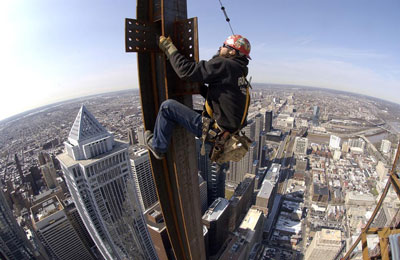 Photo of Ironworkers over Atlanta's skyline. They face one of the highest risks of death of any occupation. Credit: Ironworkers Local 387.